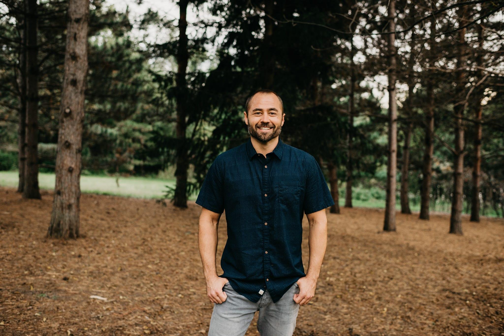 Forest portrait of Minneapolis Wedding Photographer Jackson Tyler Eddy, owner of A Frame Forward Photography