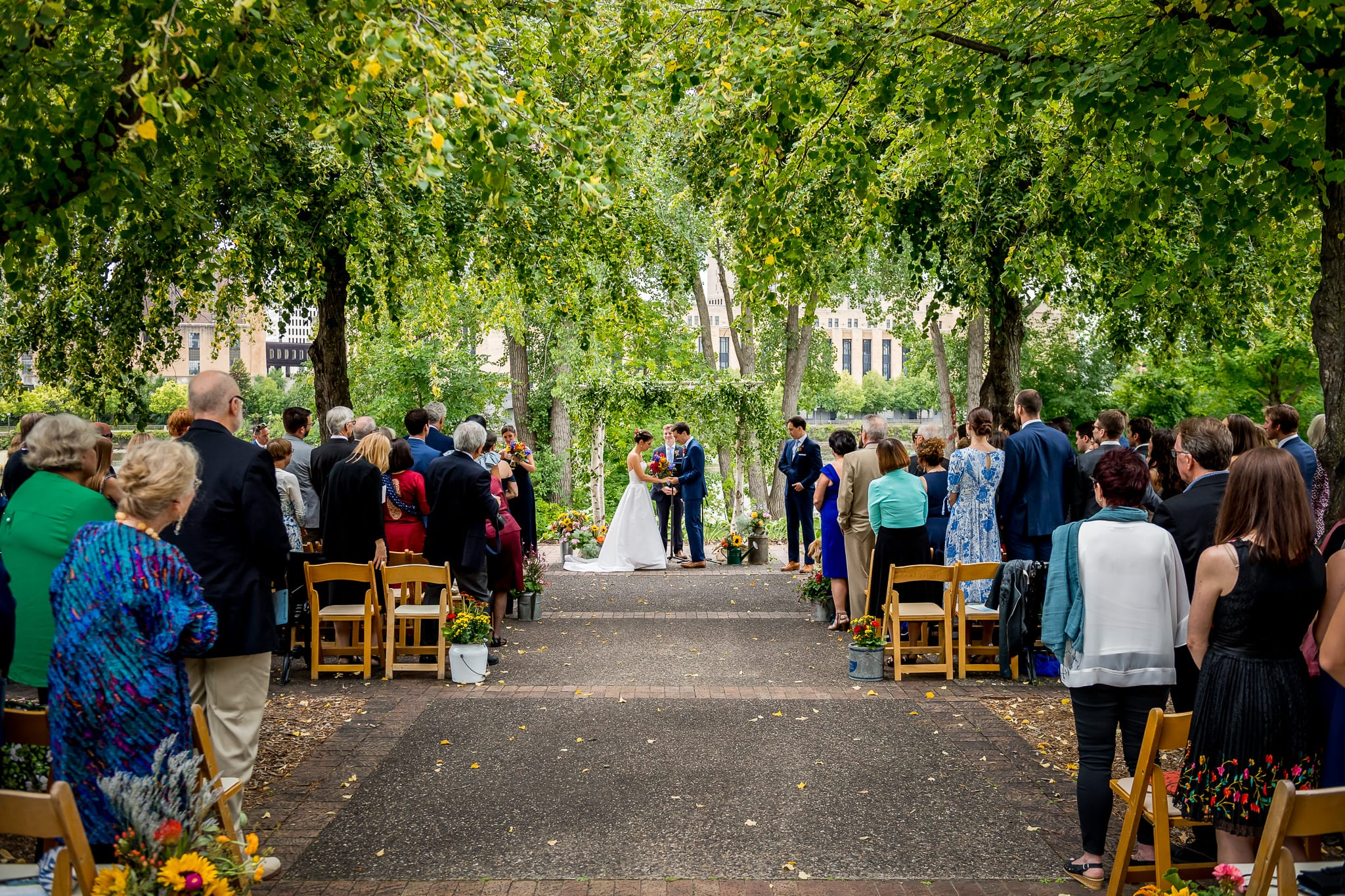 Wide view of the outdoor wedding ceremony at the Nicollet Island Pavilion