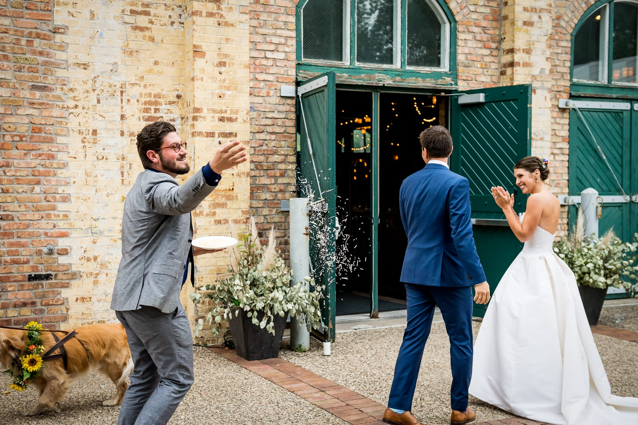 "Real life ""parmesan cheese boy at your wedding"" throws cheese at the newlyweds"