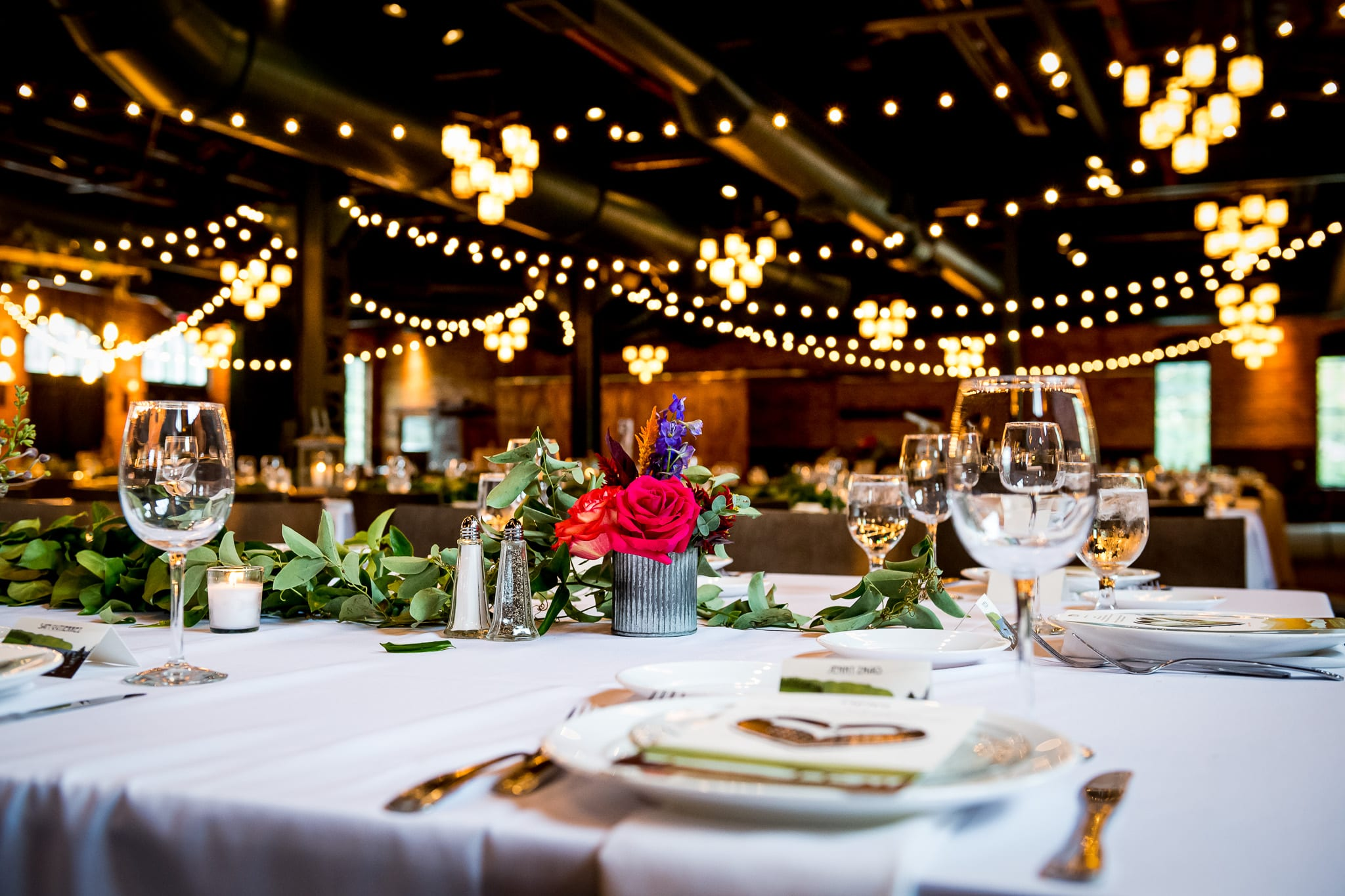 Gorgeous table setting during a wedding inside of the Nicollet Island Pavilion