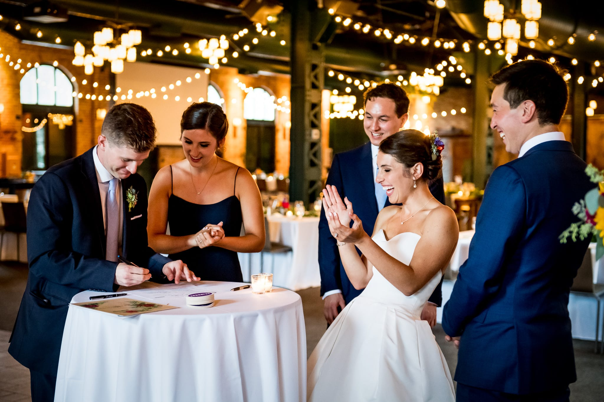 Bride laughs hysterically as her sister filled out the wrong section on their wedding license