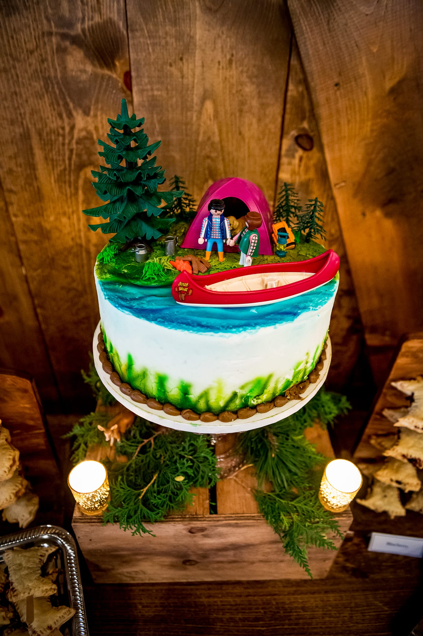Northern themed wedding cake with camping and a canoe