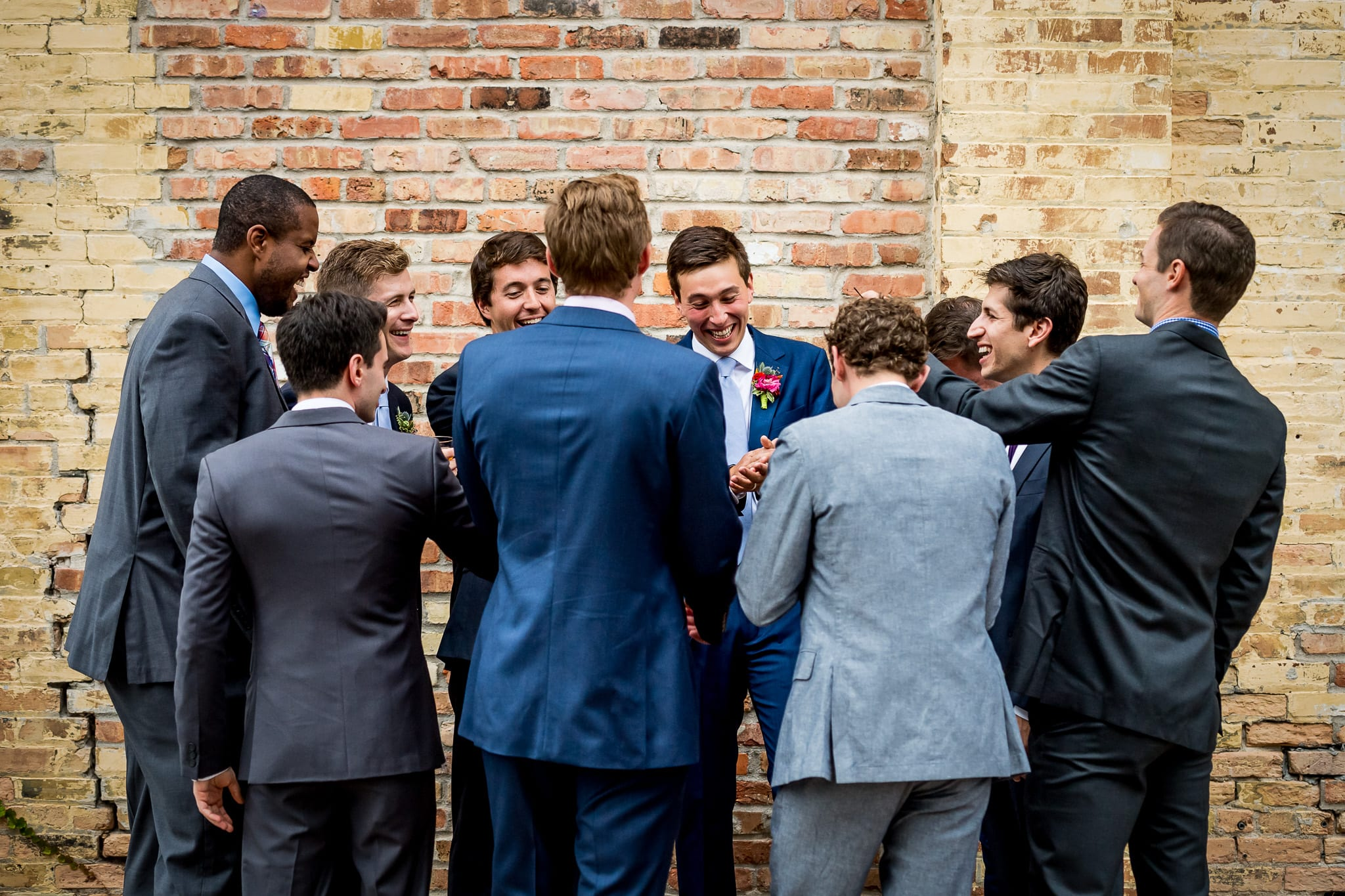 Groom and his friends sharing a big laugh
