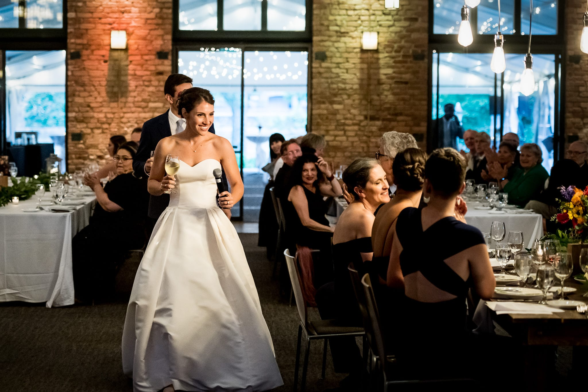 Bride and groom enter the Nicollet Island Pavilion for their grand entrance on their wedding day