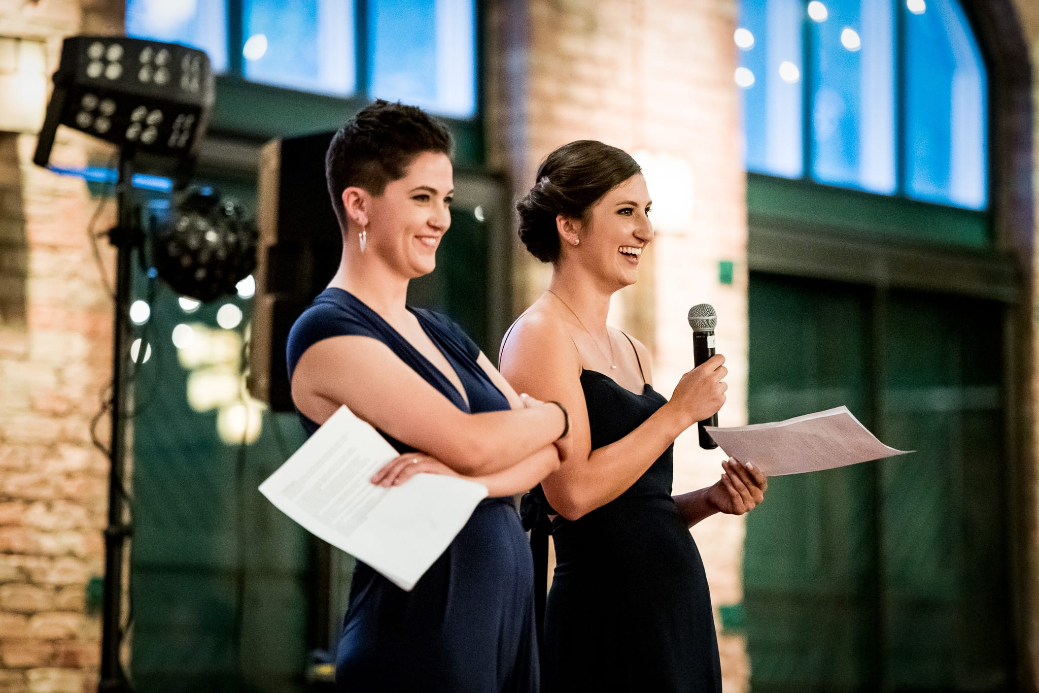 The brides sisters laughing during their speeches