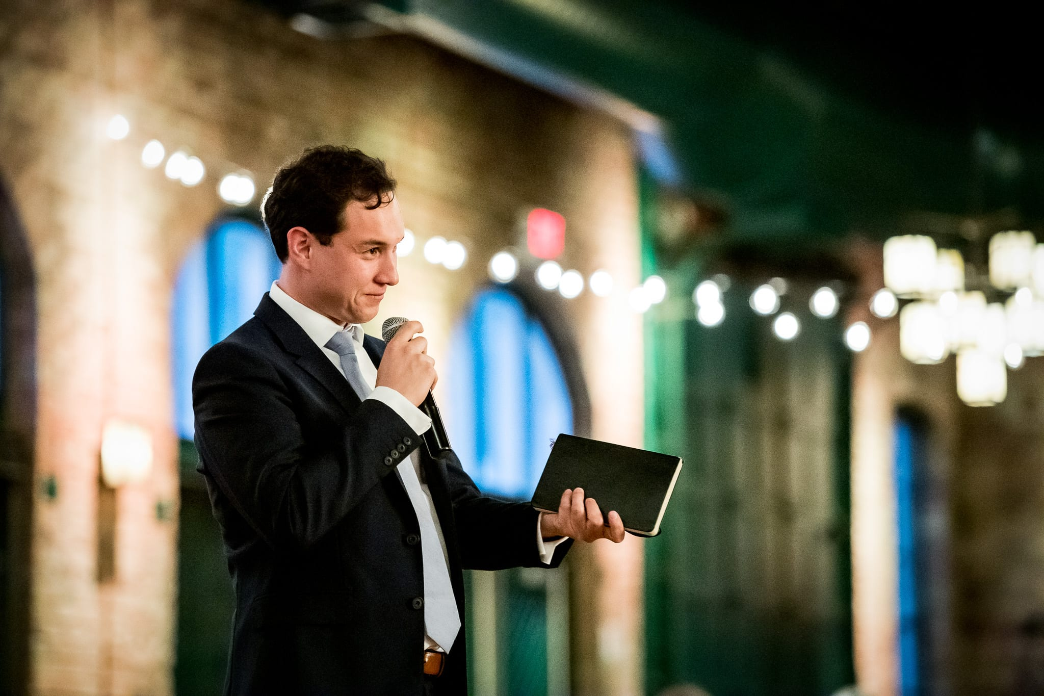 Best man gives his speech inside of the Nicollet Island Pavilion
