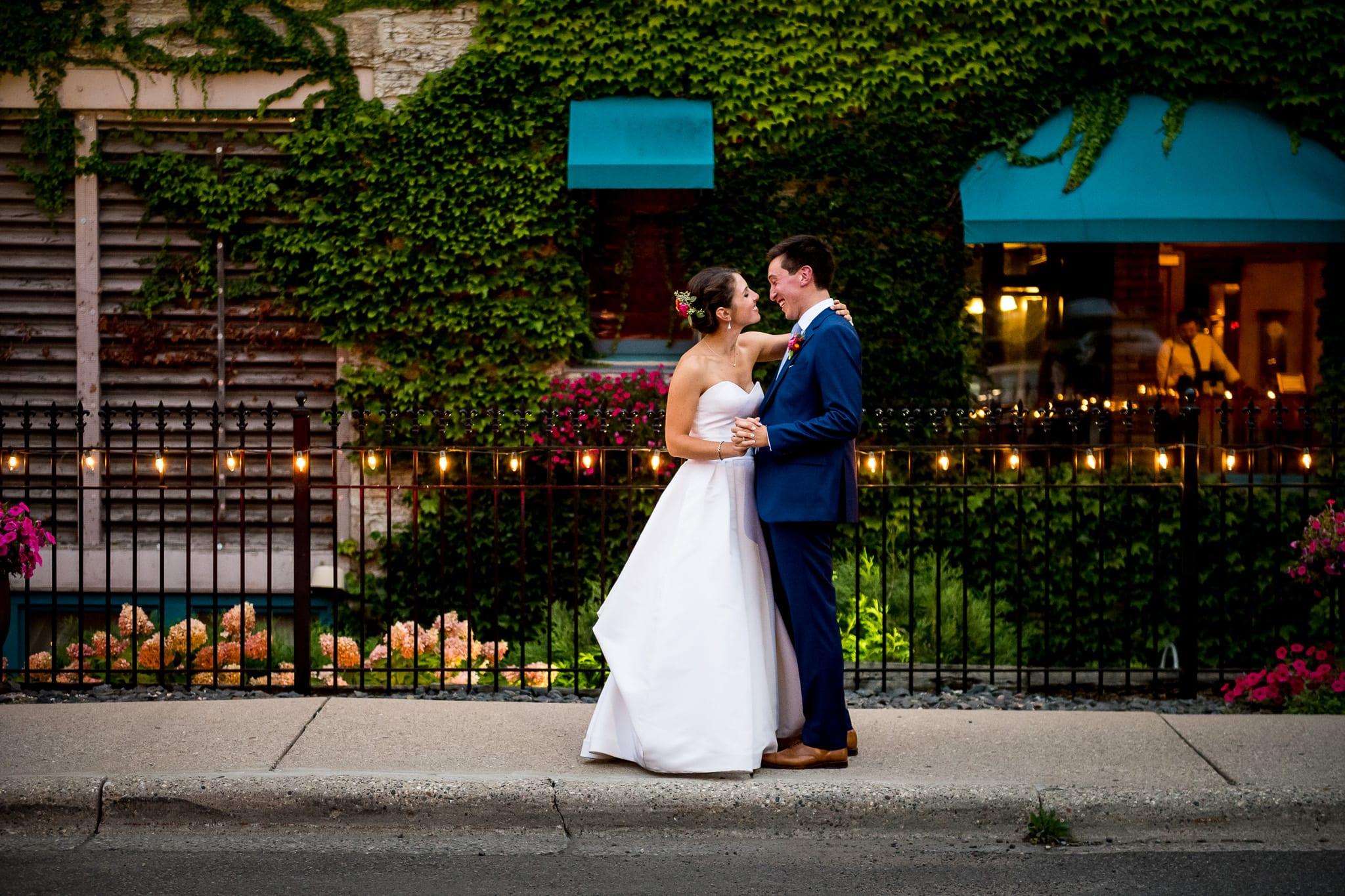 Close up of couple smiling in front of their hotel at the Nicollet Island Inn