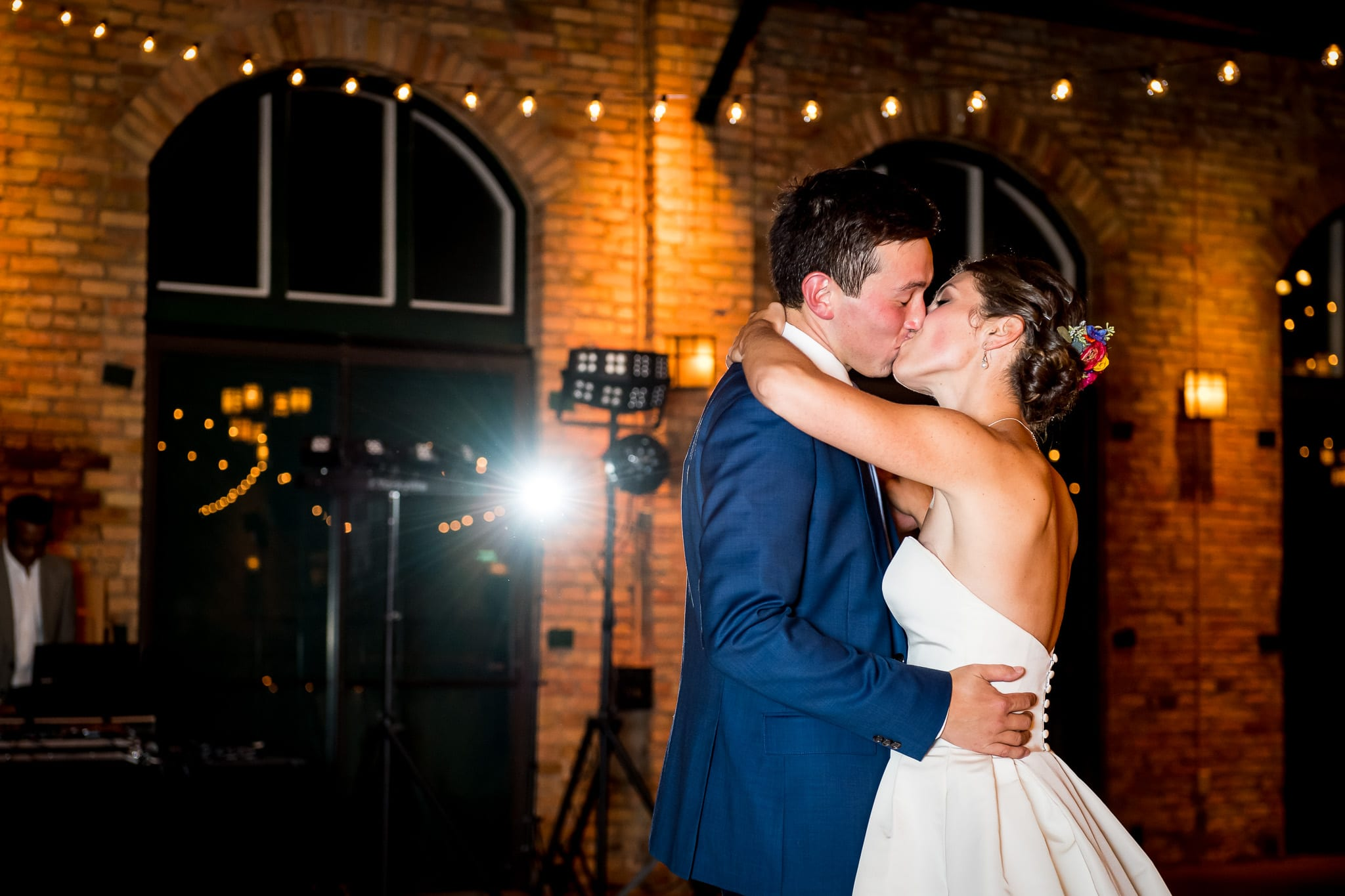 Bride and groom kiss on the dance floor during their first dance