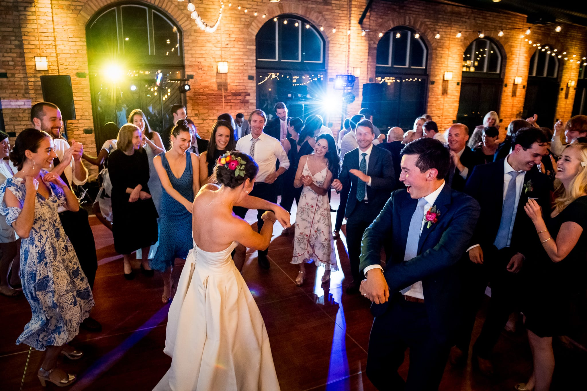 "Bride and groom do the ""Gangnam Style"" dance surrounded by their wedding guests at the Nicollet Island Pavilion"