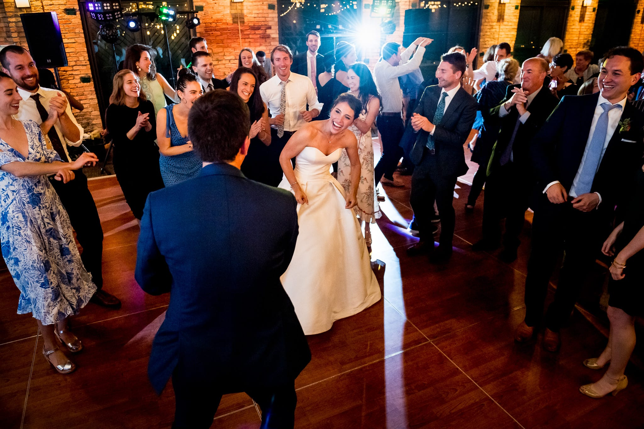 Bride laughing as she dance in the circle