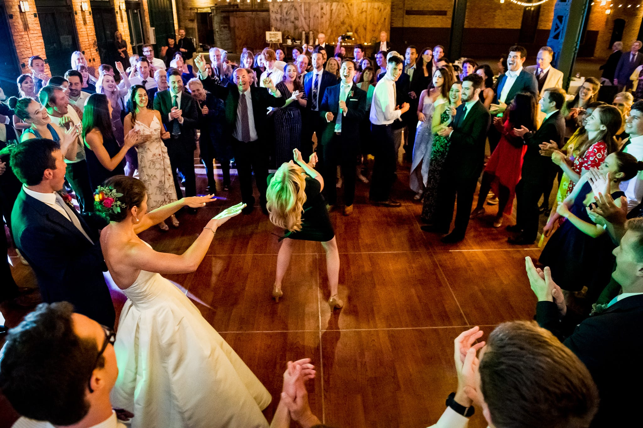 Wedding guest dips way back in the dance circle