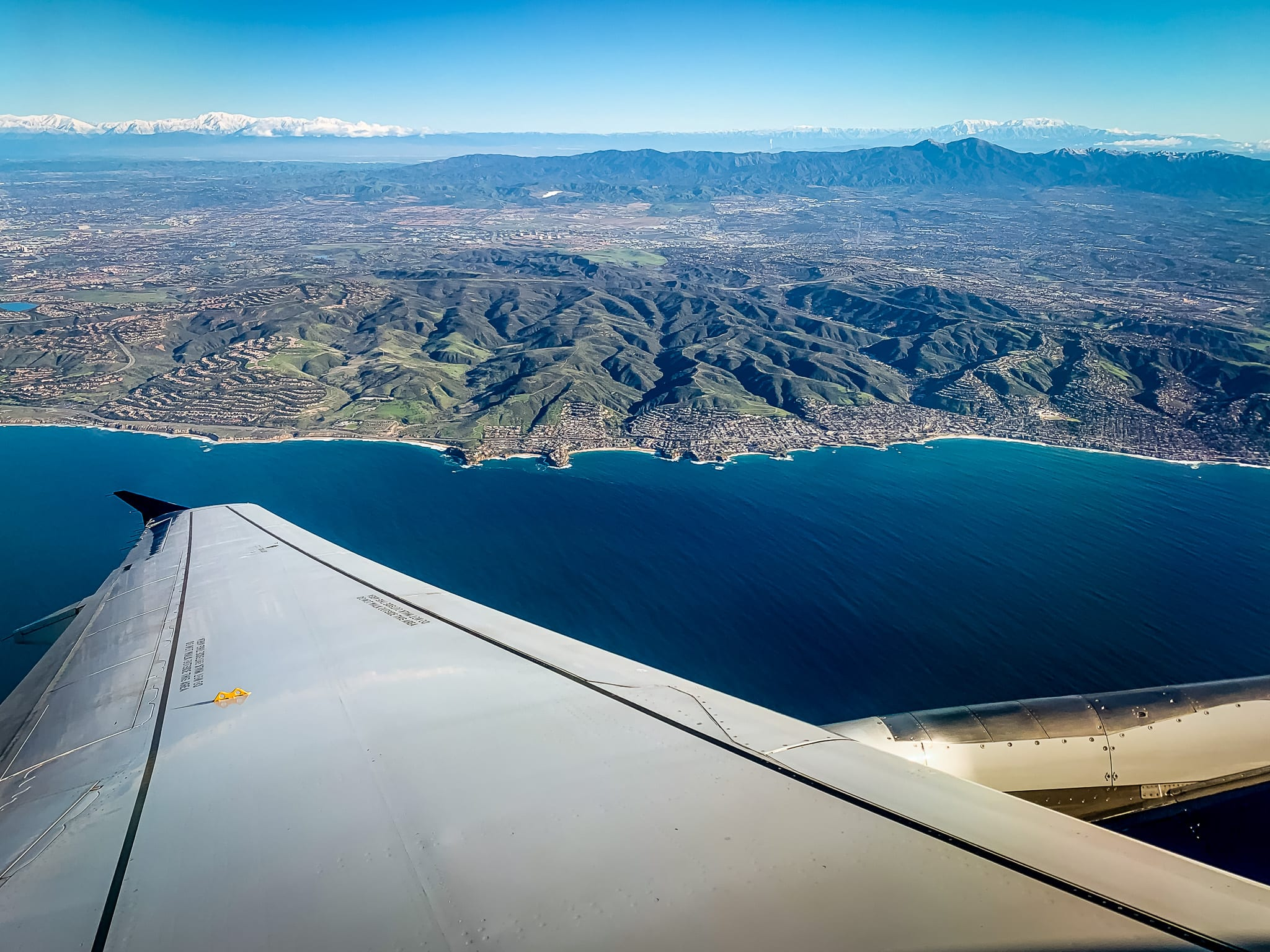 Aerial view of Laguna Beach from an airplane window giving an overview of the area and topography