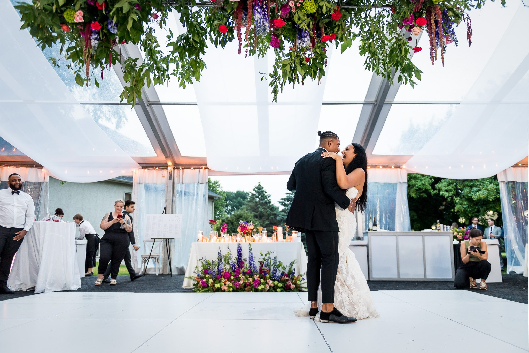 Bride and Groom share their first dance under a beautifully decorated tent at their backyard wedding in Minnesota.